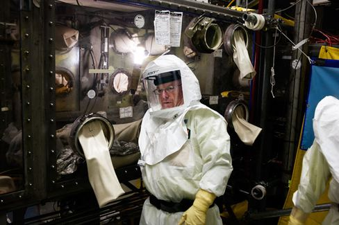 Inside the Plutonium Finishing Plant: A technician at work on a glovebox