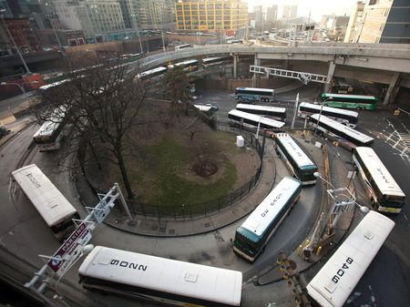 Buses wait in line to enter the Port Authority Bus Terminal in New York on April 2, 2014. Once a vital force in the regional economy, the Port Authority has been sapped by mountingdeficits.
