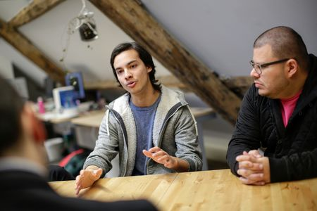 Daniel Salas, co-founder of Leaf.fm, left, gestures as he speaks as Gilbert Corrales, chief executive officer of Leaf.fm, looks on during an interview at the Leaf.fm headquarters in Newcastle upon Tyne