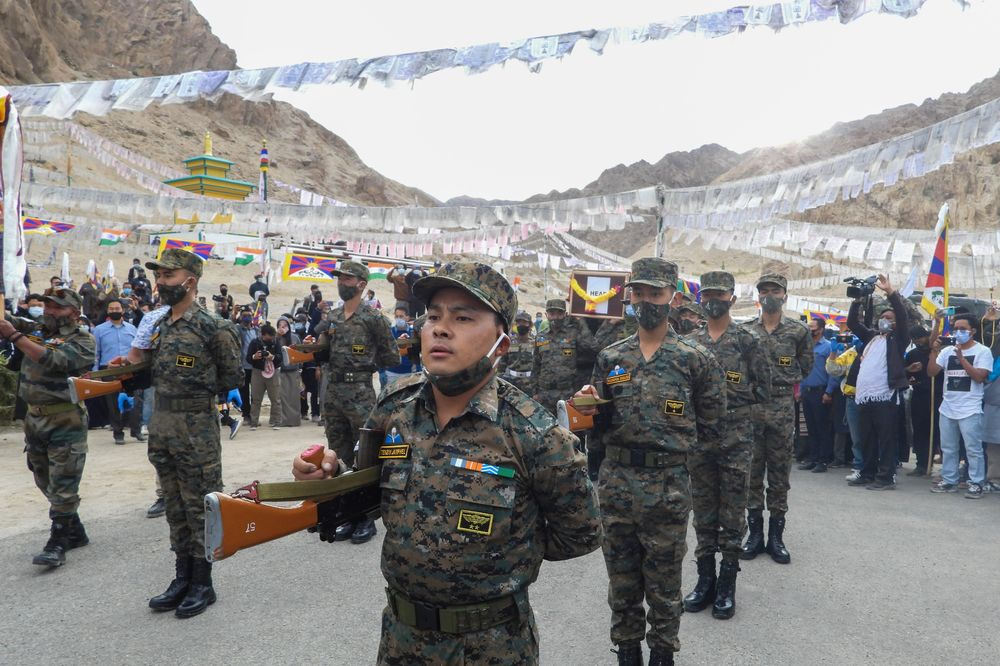 Indian troops pay respects to their fallen comrade, Tibetan-origin special forces soldier Nyima Tenzin in Leh on Sept. 7.