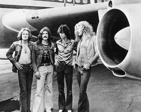 Led Zeppelin in front of their private airliner The Starship, in 1973.