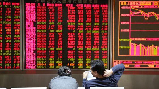 Chinese Stocks Cap Worst NPC Loss Since 2009 Despite Late Rally