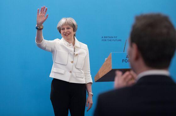 U.K. Conservatives Split by Brexit Seek to Unite for Survival