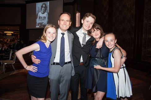 Her Justice honoree Lisa J. Donahue, global head of turnaround and restructuring services at AlixPartners LLP, with her family. Photographer: Marian Goldman via Bloomberg