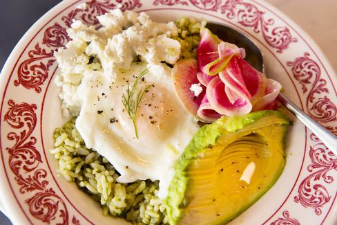 The sorrel pesto rice bowl in all its glory, with shaved radishes and French feta.