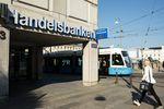 A public tram passes the offices of Svenska Handelsbanken in Gothenburg, Sweden.