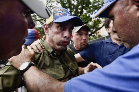 Capriles affected by tear gas during demonstrations on June 7.