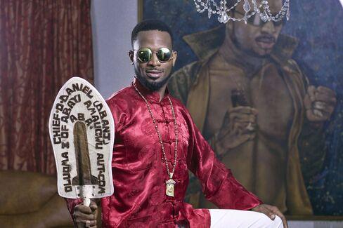 D'banj poses at his home in Lagos