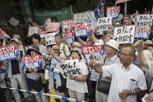 Anti-U.S. airbase demonstrators protest in front of the Japanese Parliament in Tokyo, Japan on June 19.