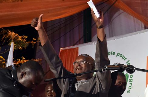 Roch Marc Christian Kabore waves to supporters