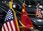US and Chinese national flags are seen o