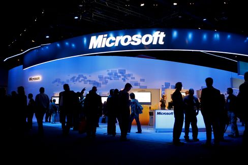 Attendees walk past the Microsoft Corp. booth
