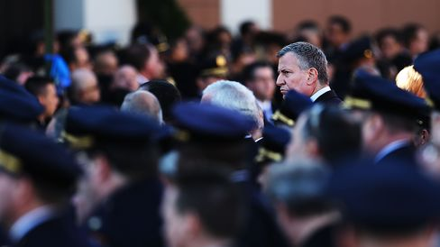 New York Mayor Bill de Blasio attends the funeral procession outside of Christ Tabernacle Church for the slain New York City Police Officer Rafael Ramos, one of two officers murdered while sitting in their patrol car in an ambush in Brooklyn last Saturday afternoon on December 27, 2014 in New York City.