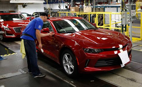 An employee works on a 2016 Chevrolet Camaro on the production line at the General Motors Co. Lansing Grand River Assembly plant in Lansing, Michigan, on Oct. 26.