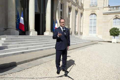 President Francois Hollande speaks to reporters today