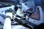 Doug Hurley, left, and Bob Behnken sit inside the Dragon crew capsule on Sunday.