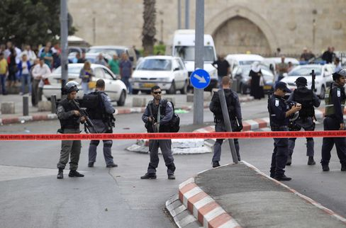 Israeli police stand guard after a Palestinian man was shot dead near the Damascus Gate on Oct. 10