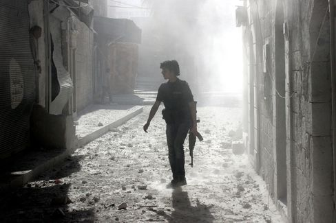 A Syrian rebel walks the streets of Aleppo, Syria.
