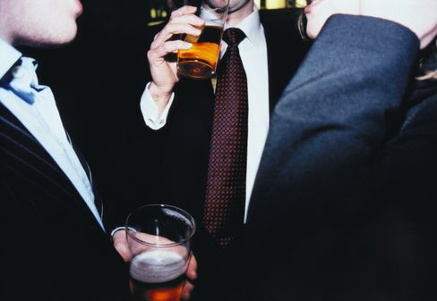 Men in Business Attire Drinking Pints of Beer