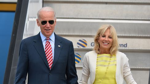 US Vice President Joe Biden (L) and his wife Jill Biden (R) walk down the gangway after landing atthe 'Henry Coanda' international Airport in Bucharest on May 20, 2014