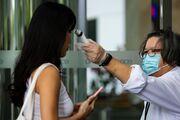 Temasek to Freeze Pay, Cut Bonuses for a Year, Amid Virus