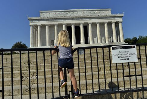 A child stands on a barricade around the Lincoln Memorial in Washington, in October 2013.