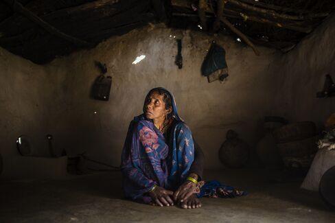 Harkiya sits alone in her house.
