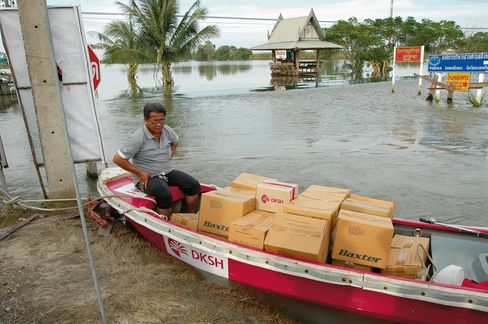A DKSH employee delivers medical supplies during flooding in Ayutthaya, Thailand in Oct. 2011.
