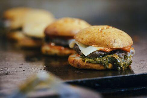 Locol Cheeseburgers are prepared.
