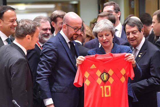 May Gets World Cup Ambush Before Brexit Pitch Battle Begins