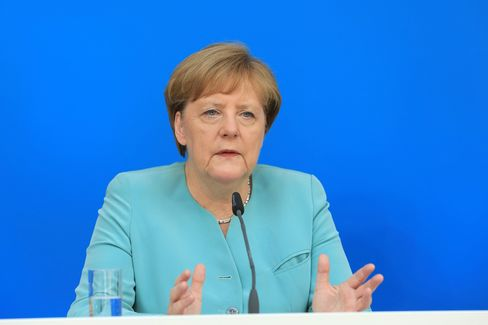 Angela Merkel speaks during a news conference in Potsdam on June 25.