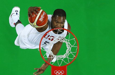 An overview shows USA's guard Kevin Durant scoring during a Men's round Group A basketball match between USA and Venezuela at the Carioca Arena 1 in Rio de Janeiro on August 8, 2016 during the Rio 2016 Olympic Games. / AFP / POOL / Jim YOUNG        (Photo credit should read JIM YOUNG/AFP/Getty Images)
