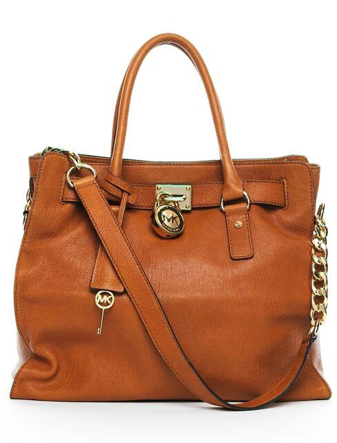 Michael Kors, Coach May Be Headed for Handbag Smackdown