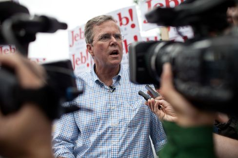 Republican Presidential candidate Jeb Bush speaks to the press at the 4th of July Parade in Merrimack, New Hampshire.