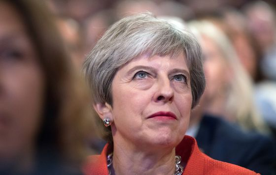 May Faces Tory Fire Over Brexit as Hammond Attacks Boris Johnson