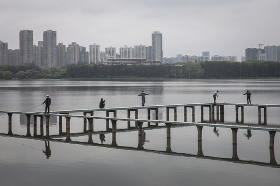 Wuhan Emerges From Lockdown With a Mission: Our Goal is Survival