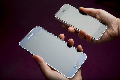 A Samsung Galaxy S5 Smartphone and Apple iPhone 5c
