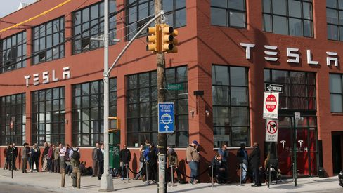 Customers gather at the new Tesla showroom in Brooklyn, New York.