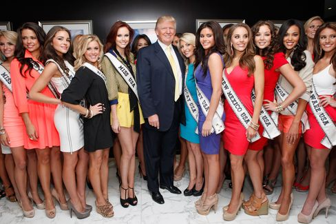 Donald Trump poses with Miss USA contestants at Trump Tower in 2012.