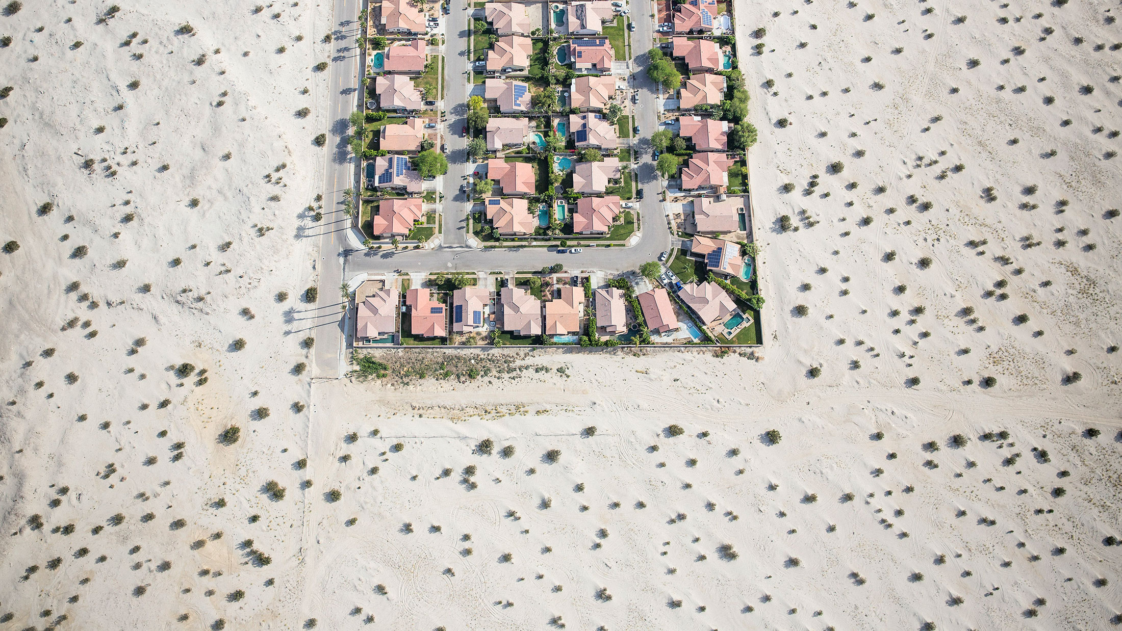 A housing development on the edge of undeveloped desert in Cathedral City, California.