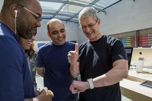 Tim Cook, chief executive officer of Apple Inc., speaks with customers at an Apple Inc. store in Palo Alto, California.