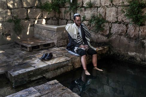 Rabbi Natan Alexander visits the spring and ritual pool in the hills of Bat Ayin, near his home, where religious men of the area arrive daily to purify themselves by praying and immersing themselves in the water.