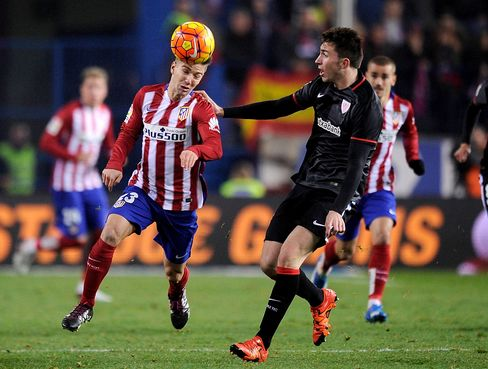 Luciano Vietto of Club Atletico de Madrid heads the ball past Mikel Balenziaga of Athletic Club.