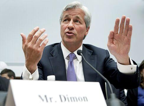 Dimon Says Curbs Needed to International Reach of Dodd-Frank