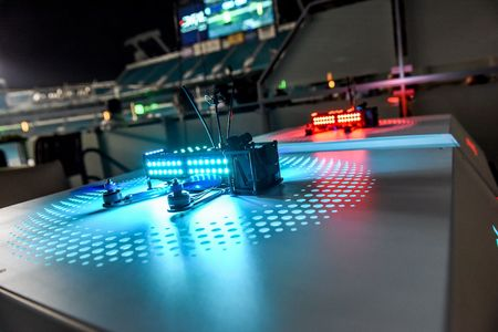 The DRL-built racing drone features four propellers and 100 color-coded LEDs. It can fly as fast as 80 miles per hour.