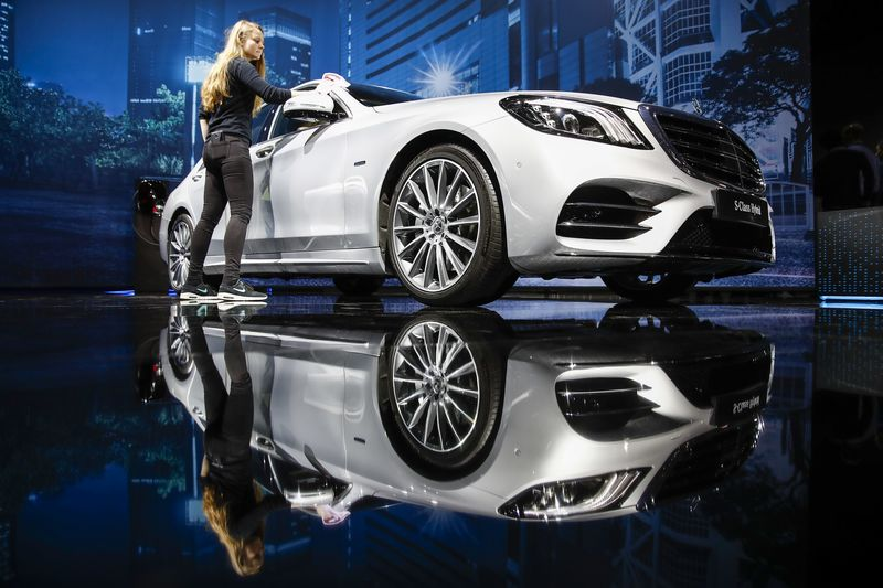 A Worker Cleans A Mercedes S Class Hybrid Automobile At A Mercedes Benz AG  Event Ahead Of The 88th Geneva International Motor Show On March 5, 2018.