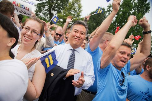 Rep. Mark Takano, D-Calif., celebrates the Supreme Court's 5-4 ruling to legalize gay marriage throughout the United States.