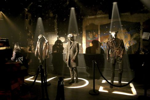 Masked models and mannequins on display at John Varvatos's atypical fall presentation at his Bowery store.