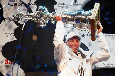Ellison celebrating on the podium in 2010 after the second race of the 33rd America's Cup off Valencia's coast in Valencia, Spain