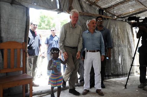 Former President Bill Clinton visits Haiti with Frank Giustra on June 29, 2014.